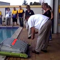 Here's what happens when you inflate an aircraft emergency slide in a pool