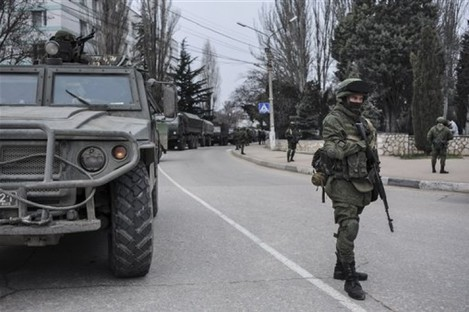 Troops in unmarked uniforms stand guard in Balaklava on the outskirts of Sevastopol, Ukraine today.