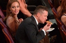 Celebrities helping themselves to the pizza Ellen ordered at the Oscars