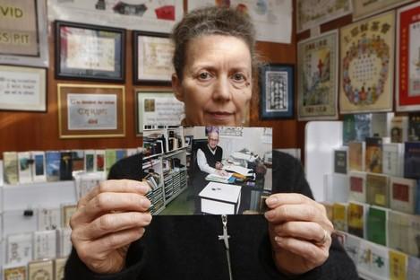 Karen Short, the wife of John Short, with a photograph of her husband.