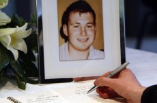 Woman held over Ronan Kerr murder