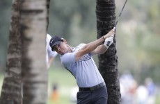 McIlroy blows hot and cold, but just two off the lead at WGC