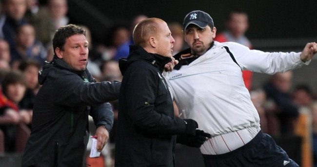 Man charged over mid-match assault on Neil Lennon