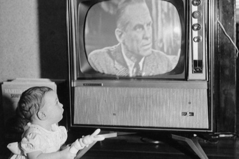 Eight-month-old Andrea Whalen watches TV in February 1961.