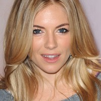 Second newspaper implicated in phone hacking scandal as Sienna Miller is awarded £100,000
