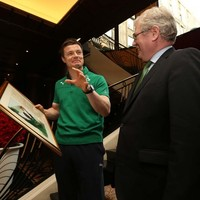 Tánaiste presents Brian O'Driscoll with framed picture of French heroics