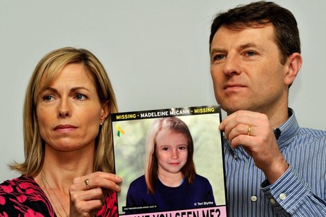 Madeleine McCann's parents Gerry and Kate hold a poster of their daughter.
