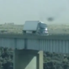 Huge lorry gets blown over while crossing bridge