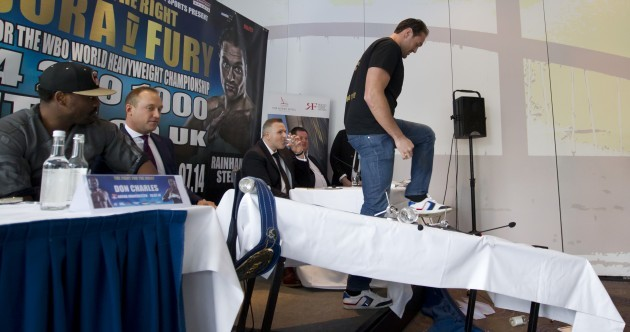 Tyson Fury shows he's really fired up for his next fight by flipping a table at a press conference