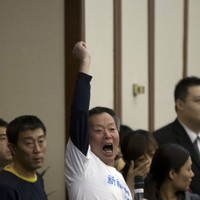 """""""Tell us the truth!"""" Police intervene as families of missing passengers confront officials"""