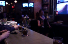Bartender throws a full pint across the pub without spilling it