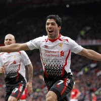 VIDEO: Suarez goals help high-flying Liverpool overcome Cardiff