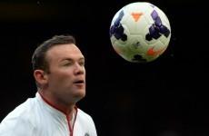 Wayne Rooney wonder lob keeps United on high