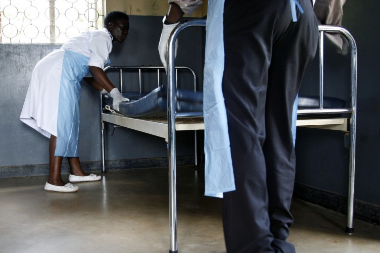 Medical personal prepare an isolation unit to care for Ebola victims
