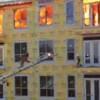Unbelievable footage shows construction worker's lucky rescue from raging fire