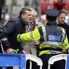 Man arrested outside Leinster House after scuffle with gardaí over Alan Shatter
