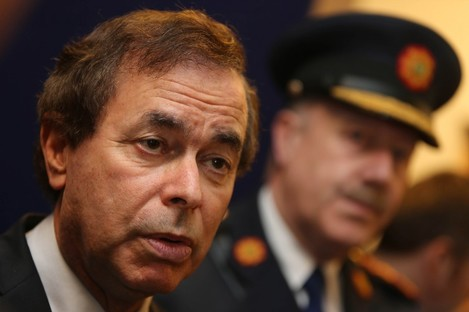 Alan Shatter and, in the background, the former Garda Commissioner Martin Callinan