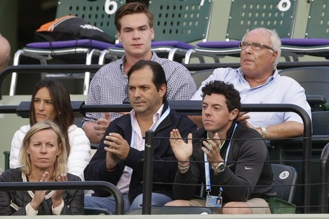 Rory McIlroy applauds as fiancee Caroline Wozniacki takes on Li Na at the Sony Open Tennis tournament in Florida.
