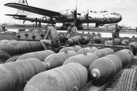 Ground crew members prepare bombs to be loaded into the racks of the waiting B-29 Superforts, at a US airbase on Saipan, in the Mariana Islands, in November 1944.