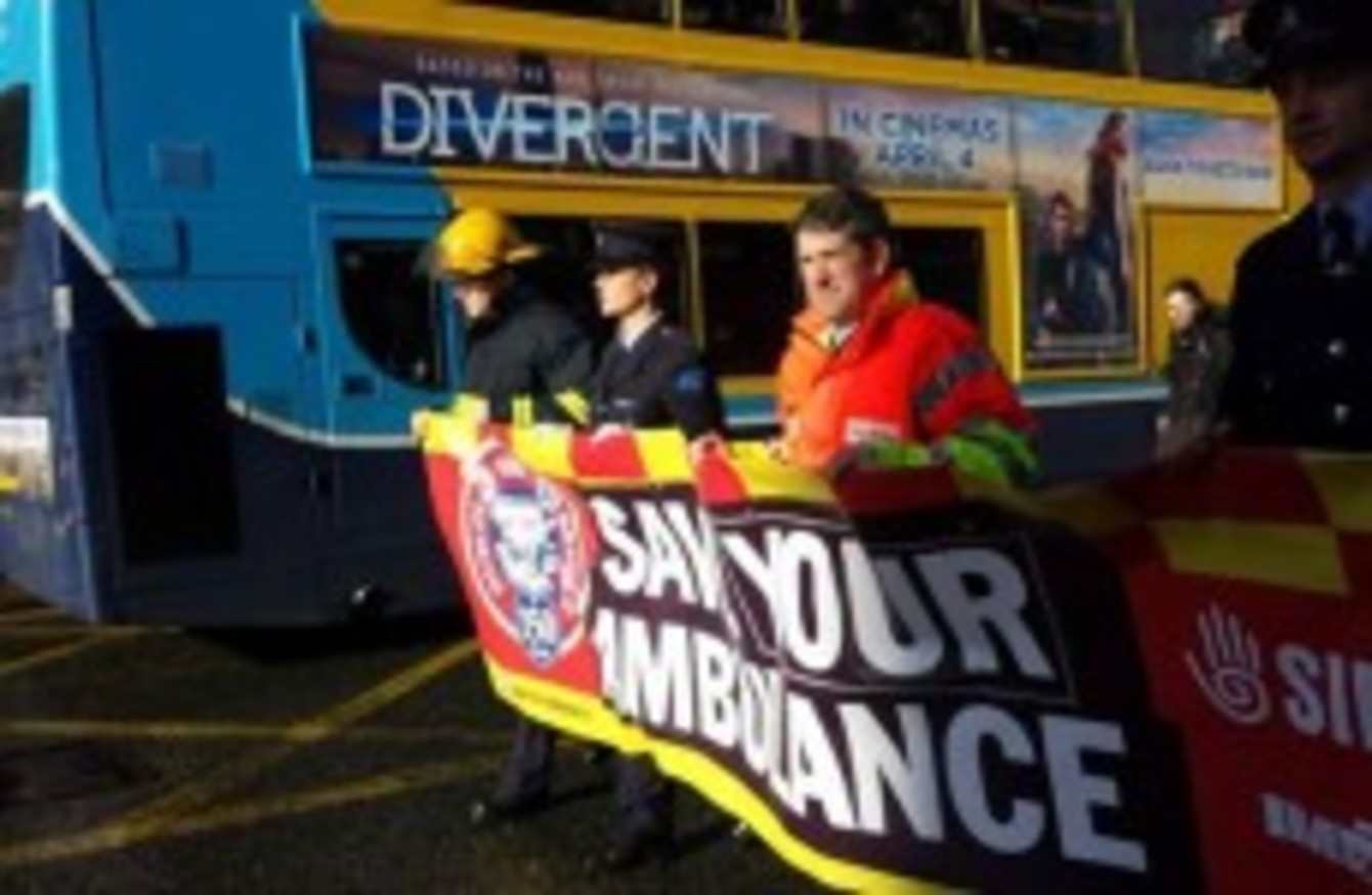 Dublin firefighters march against ambulance service being