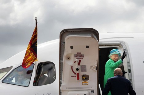 The Queen waves to the assembled dignitaries as she and Prince Philip prepare to leave Cork Airport earlier today.