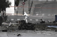 Booby-trapped car explodes outside bank in Athens