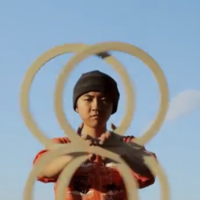This hoop juggler's magical moves are hypnotic