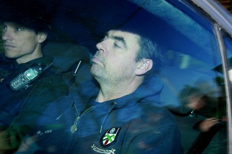Seamus Daly arrives in a police car at Dungannon Court.