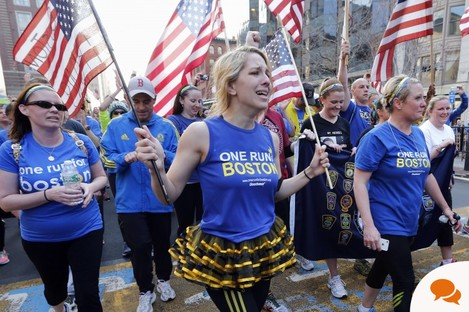 Participants in a cross country charity relay that began in March in California cross the finish line of the Boston Marathon in Boston, Sunday, April 13, 2014. Boston Marathon bombing survivors, family members and supporters joined the relay runners for the final half-block to the finish. (AP Photo/Michael Dwyer)
