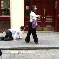 The mystery of the man being walked on a lead around London has been solved
