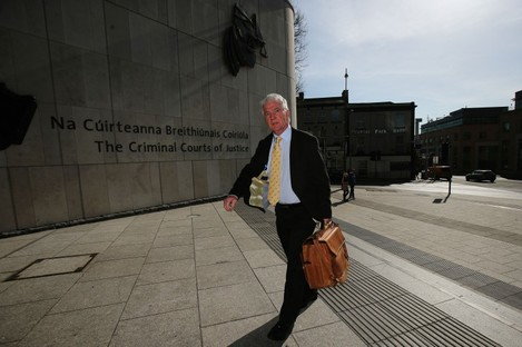 Sean FitzPatrick, the former chairman and one-time chief executive of Anglo Irish Bank, arrives at the Circuit Criminal court, Dublin yesterday.