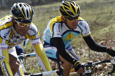 """Lance Armstrong, right, with George Hincapie. A report by """"60 Minutes"""" says Hincapie, a longtime member of Armstrong's inner circle, has told federal authorities he saw the seven-time Tour de France winner use performance-enhancing drugs."""