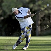 Somebody let John Daly hit a golf ball out of their mouth