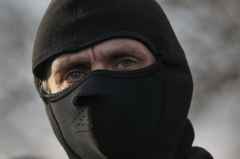 A pro-Russian activist makes barricades in eastern Ukraine.