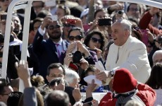 Pope Francis gives two kids a lift on the PopeMobile and has the craic with them