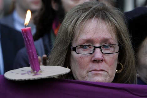 Angela Downey, whose mother was a Magdalene Laundries survivor, attends a vigil at Leinster House.