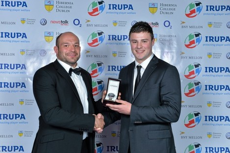 Rory Best presents Robbie Henshaw with the young player award in 2013.