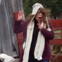 This girl is absolutely terrified by a goat's sneeze