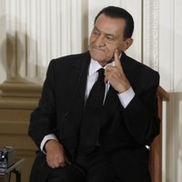 Egypt's Mubarak and two sons charged over protest deaths