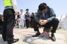Race to recover bodies from Korea ferry before storms hit