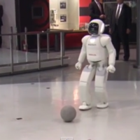 Oh nothing, just Barack Obama playing soccer with a Japanese robot
