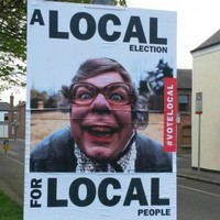 Spoof local election poster is equal parts creepy and wonderful