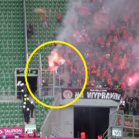 The horrifying moment when tear gas engulfed a flare-waving football fan