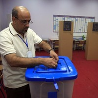 Mortars target Iraq voting centres as polls open in first election since US troops left