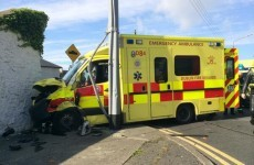 Crew injured after ambulance crashes into wall
