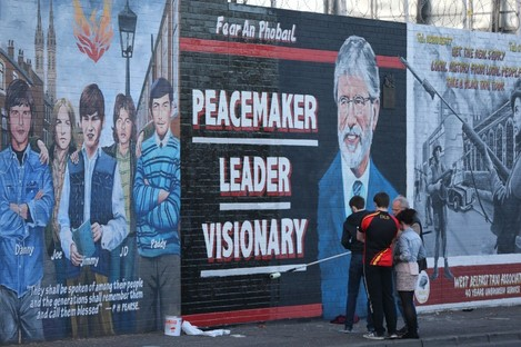 A mural of Sinn Fein Leader Gerry Adams is painted on a wall on the Falls Road, Belfast