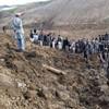 More than 2,000 dead in 'mass grave' after landslide buries entire village