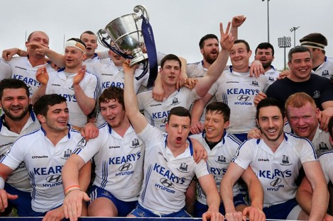 Cork Con celebrate their Bateman Cup success.