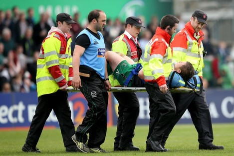 Jason Harris-Wright is carried off the pitch on Saturday.