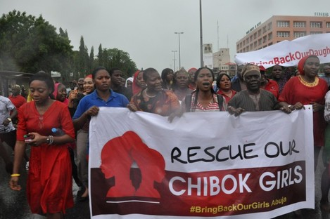 Women attend a demonstration calling on the government to rescue kidnapped schoolgirls.